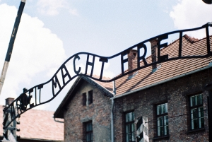 """Entrance gate of the former Auschwitz concentration camp with the Scriptures """"Arbeit Macht Frei"""" Eingangstor des ehemaligen Konzentrationslagers Auschwitz mit der Schrift """"Arbeit Macht Frei"""""""